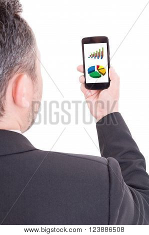 Modern business man checking financial statistics with charts using smartphone