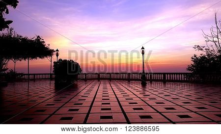 Textured of stone pavement floor and lamp post during colorful morning