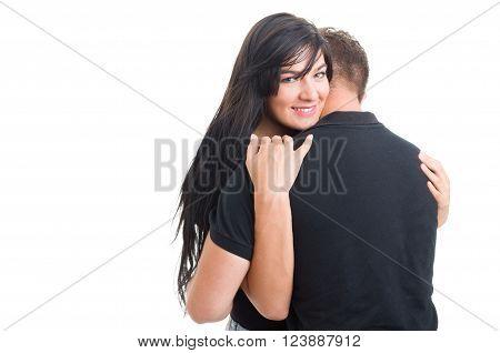 Happy woman inlove hugging man or boyfriend on white studio background