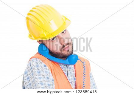 Busy Constructor Or Builder Holding Phone Between Ear And Shoulder