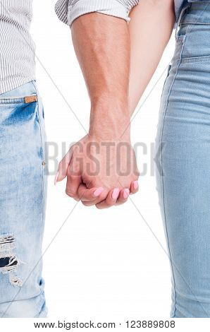 Vertical Closeup Of Couple Hands Holding Together