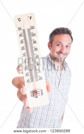 Smiling man holding thermometer isolated on white