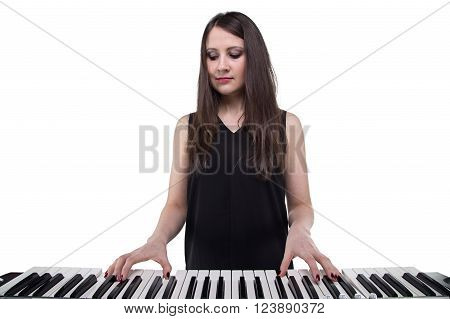 Young woman and synthesizer on white background