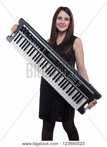 Smiling woman holding synthesizer on white background