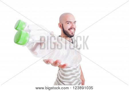 Smiling Man Holding Two Bottles Of Cold Water