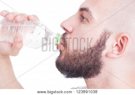 Close Up With Guy Drinking Water From Plastic Bottle