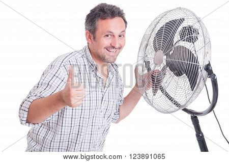 Smiling Man Showing Like In Front Of Blowing Cooler