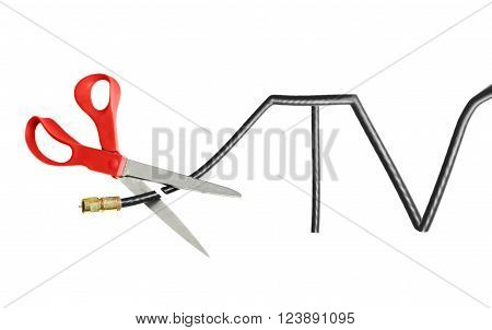 Scissors cutting through a TV shaped coaxial cable -- cord cutting concept