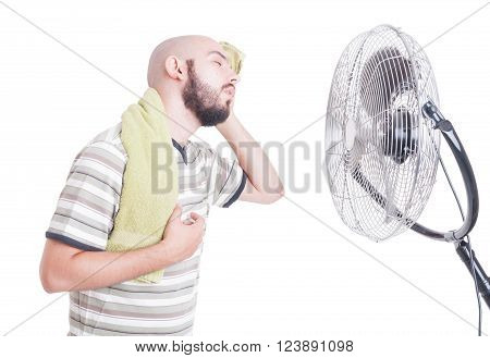 Heated Man Wiping Sweat In Front Of Cooler