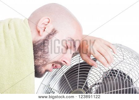 Exhausted Man Resting On Blowing Fan Or Cooler