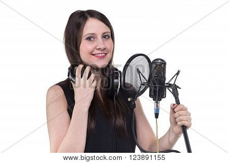 Smiling woman in headphones, recording of vocal on white background