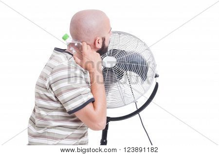 Man cooling down with blowing fan and cold water isolated on white