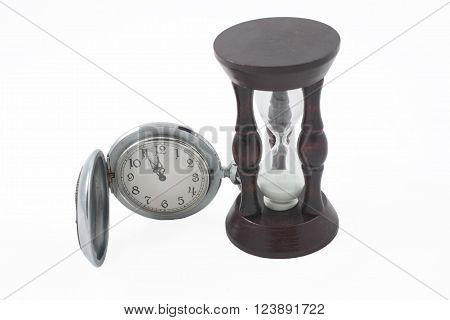 Antique pocket watch and wooden hour-glass (isolated on white)