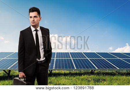 Salesman Or Businessman Holding Briefcase On Solar Power Panels Background