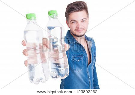 Handsome Male Model Offering Two Bottles Of Cold Water