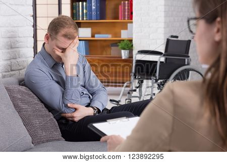 Shot of a disabled young man during a psychotherapy session with his psychologist