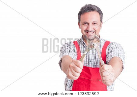 Smiling Mechanic Holding Adjustable Wrench