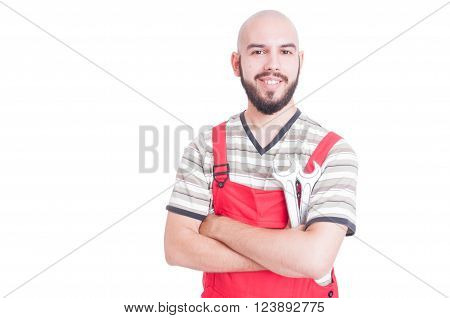 Friendly Plumber Or Mechanic Smiling And Holding Wrenches