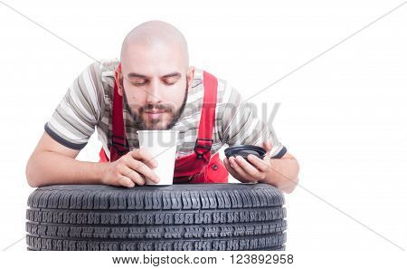Mechanic Smelling Fresh Coffee