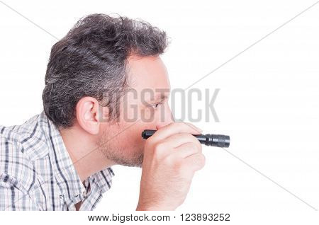 Detective or criminologist inspecting using small flashlight isolated on white with copy space