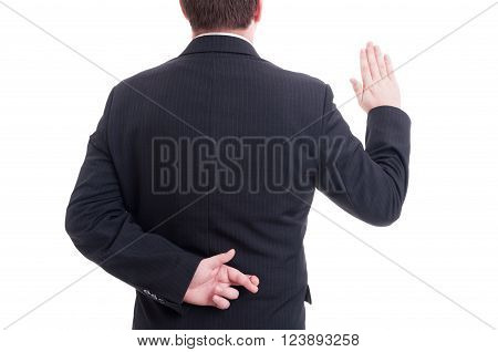 Business Man Swearing False With Crossed Fingers Behing Back