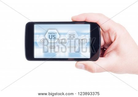 Contact us concept with hand holding smartphone. Email address website or phone options.