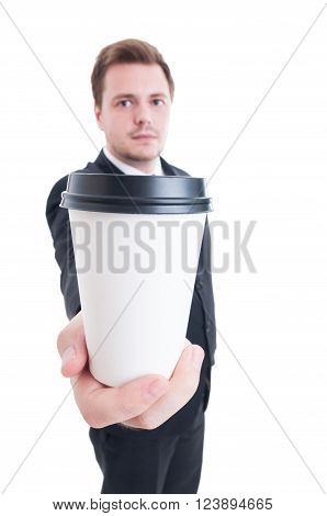 Business Man Holding A Coffee To Go
