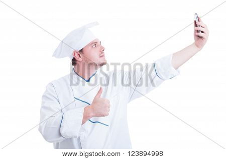 Chef Or Cook Taking Selfie With Phone Camera Showing Like