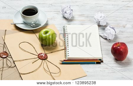 Top view of creative writing concept with papers on wooden table
