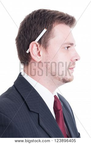 Suited Man Holding A Cigarette Behind Ear