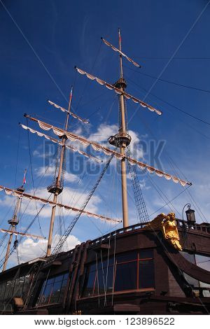 Three-masted sailing ship at close-up against the sky