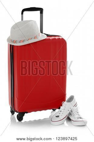 Suitcase with hat and gumshoes isolated on white
