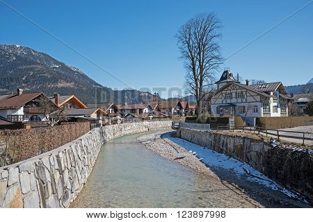 stream runway loisach river flowing through garmisch-partenkirchen early springtime