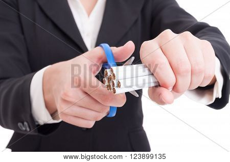 Woman Cutting A Hand Of Cigarettes Using Scissors Or Shears