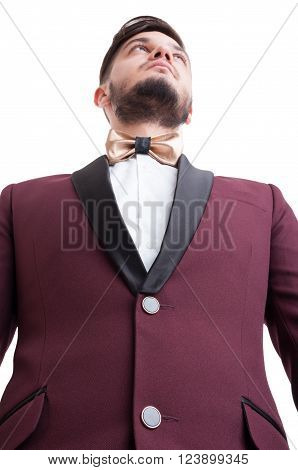 Hero shot of male model wearing suit and golden leather custom painted bowtie