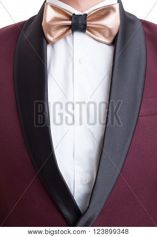 Elegant suit jacket and golden leather custom made bowtie. Elegant fashionable and modern concept