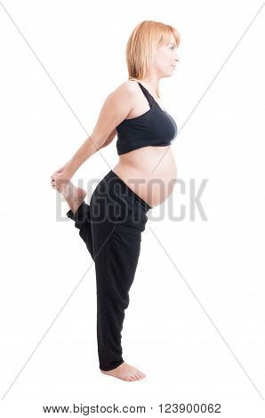 Pregnant Woman Stretching Legs Standing In One Leg