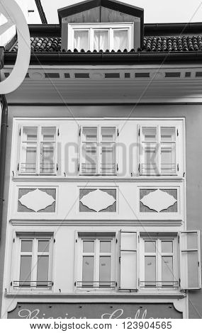 Detail of the white facade of a historic residence in Bolzano Italy.