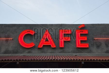 lighted Neon Sign spelling Cafe at dusk