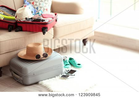Packed grey suitcase on the floor, close up