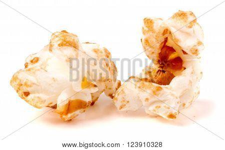 macro shot of popcorn on white background.
