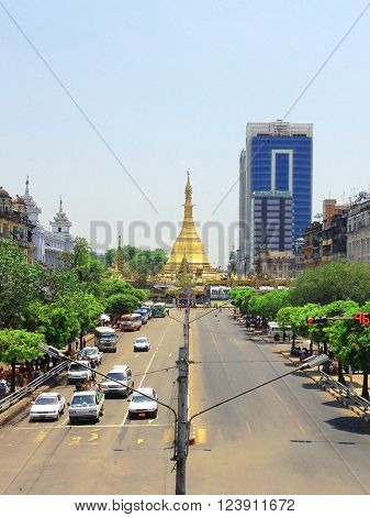 YANGON. MYANMAR - April 15, 2013: View of Sule pagoda from Sule Paya Road. Sule paya located in Yangon's downtown.