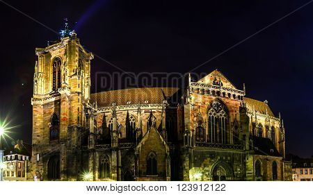 Night Panoramic View Of Sainte Martin Cathedral In Colmar
