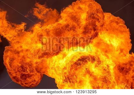 Huge explosion flames against the dark sky