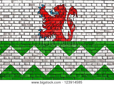 flag of Westland painted on brick wall