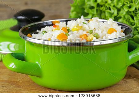boiled rice with various vegetables (carrots, corn and green peas)