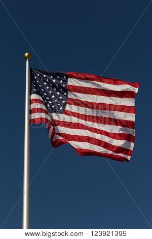 US flag on a pole waving in the wind