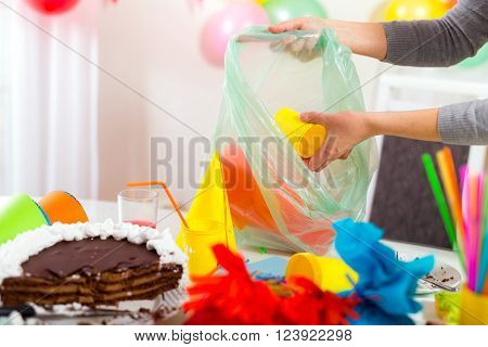 Woman cleans mess after the children's birthday