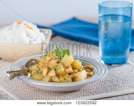 Cau cau, a typical Peruvian tripe and potato stew served in light colored bowl on textural place mat