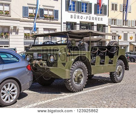 Zurich, Switzerland - 1 August, 2013: a military transporter parked on Munsterhof square. Zurich is the largest city in Switzerland and the capital of the Swiss canton of Zurich.
